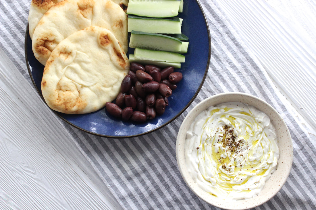 Labneh with naan, cucumbers and olives