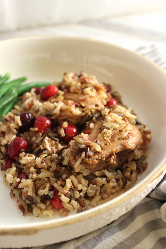 Close up view of slow cooker chicken with wild rice and cranberries