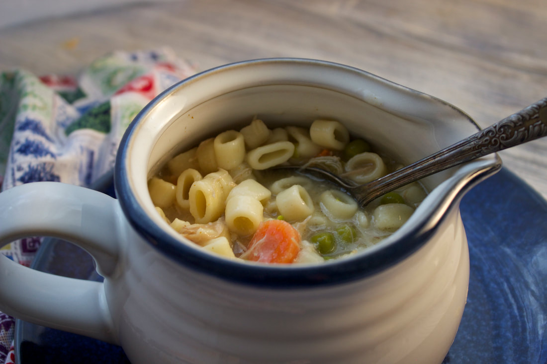 Cup of yummy turkey noodle soup